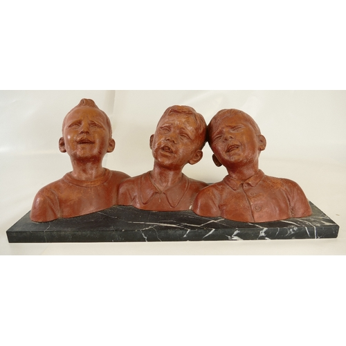 903 - French terracotta triple bust model of three young boys singing, signed to reverse and mounted on ma...