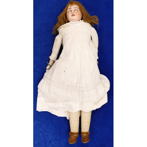906 - Bisque Head Doll c1900, with half leather body and arms.  Bears the name Special ? or similar to low...