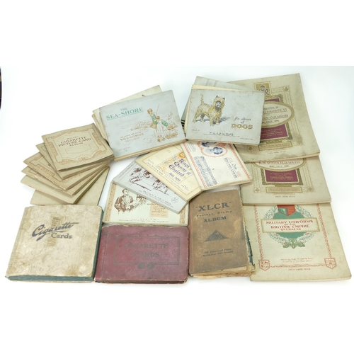 914 - A collection of vintage cigarette cards including various 1930s  albums of Wills and John Player (32...