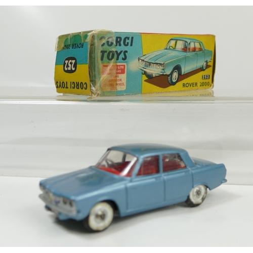 1023 - Corgi 252 Light Blue Rover in fair condition and in original fair condition box....