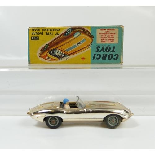 1029 - Corgi 312 Silver E-Type Jag in near mint condition and in excellent condition original box. With cha...
