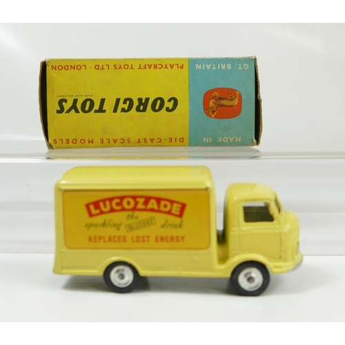 1039 - Corgi 411 Yellow Bantam Lucozade Van in near mint condition and good to excellent condition box....