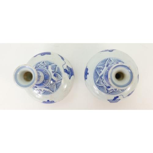 1053 - Pair of Chinese blue & white vases 18cm high....