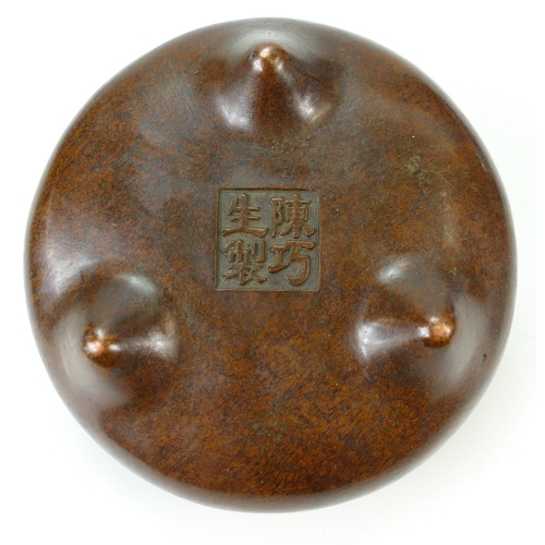 1055 - Chinese bronze circular incense burner with cast signature to base.  11cm x 6cm high....