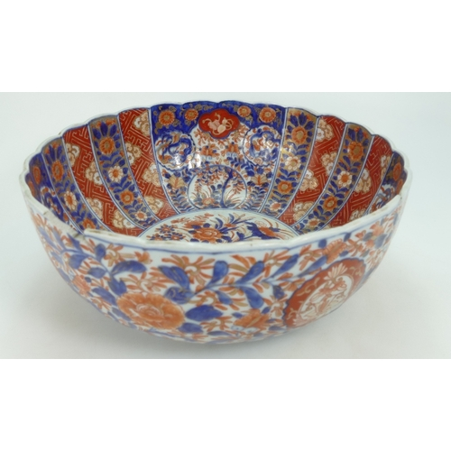 1066 - 19th century large Japanese Imari bowl with floral decoration, diameter 37cm. (Large piece re stuck ...