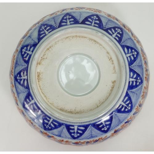 1066 - 19th century large Japanese Imari bowl with floral decoration, diameter 37cm. (Large piece re stuck ...