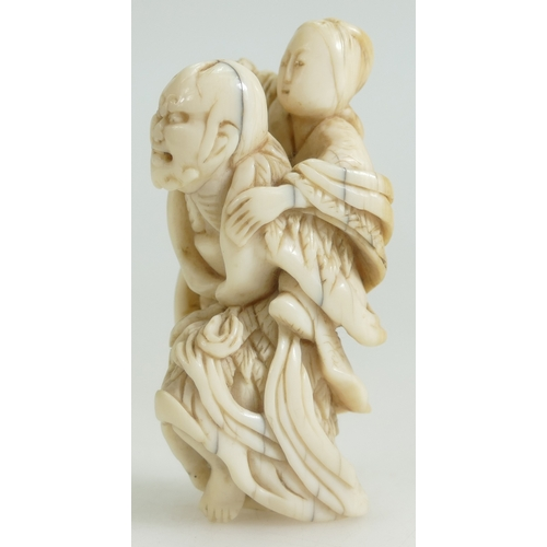 1078 - 19th century Japanese carved Netsuke peasant carrying son, length 7.5cm....