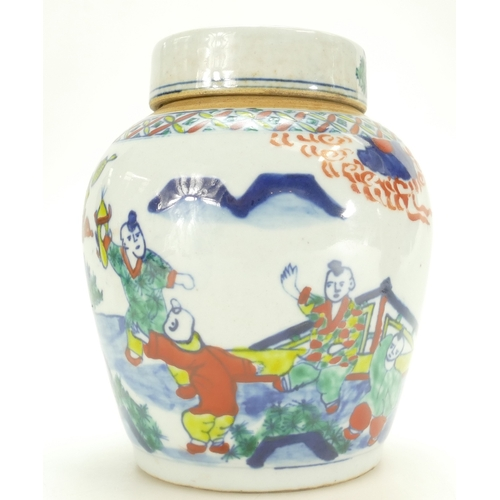 1080 - 20th century Chinese earthenware jar & cover decorated with Famille-verte, height 17cm....