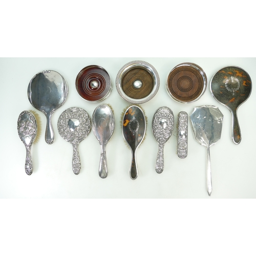 1176 - A quantity of Silver items including various brush & mirror sets, bottle coasters etc (12)...