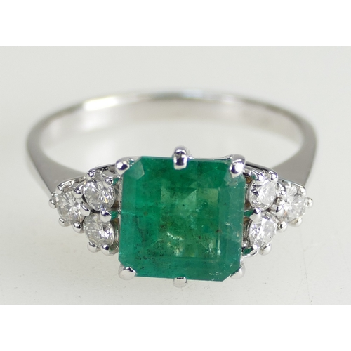1261 - EMERALD AND DIAMOND RING - square cut stone with six Diamonds size R1/2. 4.9g total....