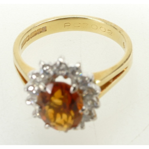 1263 - Orange coloured real gemstone ring - possibly orange Sapphire - size M weight 4.6g. 18ct gold....