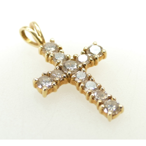 1264 - 18ct Gold and Diamond CRUCIFIX 3cm high carat. In excess of 1ct of diamonds. 2.7g...