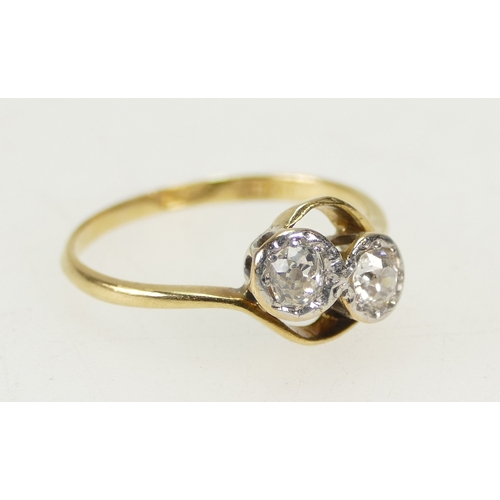 1267 - 18ct Yellow Gold 2 DIAMOND twist ring, the stones together about 0.50ct (half carat) approx. Ring si...