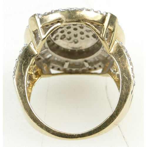 1270 - Large DIAMOND CLUSTER 9ct gold ring, set with dozens of round and baguette cut diamonds weighing aro...