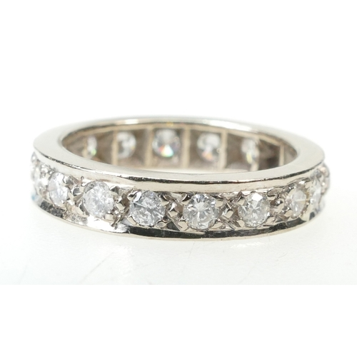 1271 - 18ct White Gold coloured metal, Diamond set (1ct plus) ETERNITY RING  (tested as 18ct gold).  18 x b...
