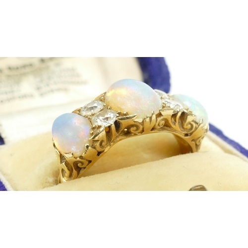 1327 - Opal and Diamond ring yellow coloured metal shank UK ring size M. Gross weight 5.5g....