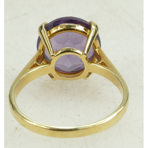 1330 - 18ct Gold and Amethyst single stone ring.  UK size R. 5.5g gross....