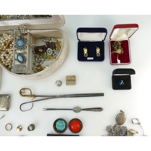 1332 - A collection of costume jewellery including brooches, pendants, necklaces, some silver items noted....