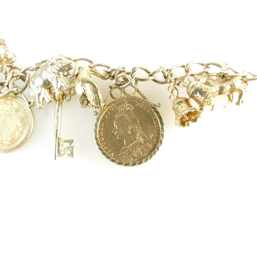 1358 - A 9ct Gold CHARM BRACELET together with a Full Sovereign (1893) and a Half Sovereign (1892) - both Y...