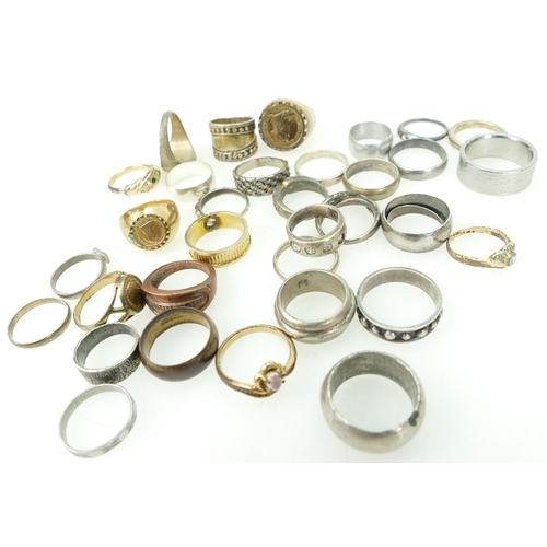 1374 - A collection of various Silver rings including signet, wedding rings, ladies and gents,136 grams and...