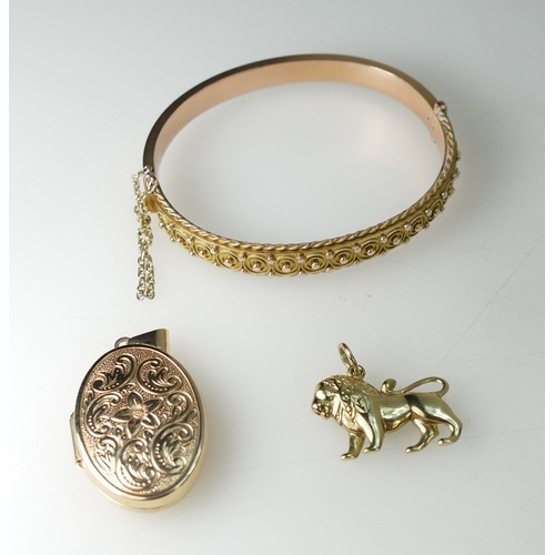 1381 - 9ct Gold Chester 1897 hallmarked Bangle, together with 9ct Locket and 9ct Lion pendant, weight 17.6g...
