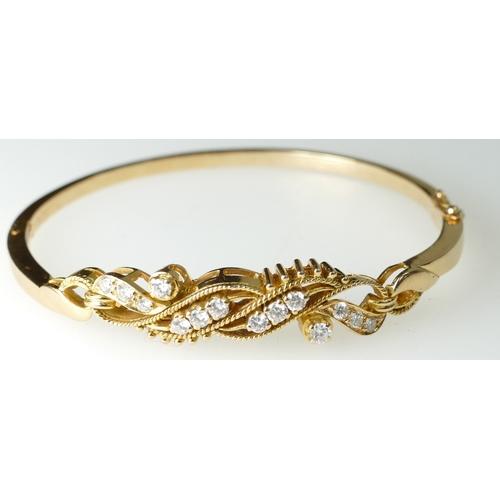 1390 - 18ct Gold Bangle set with 14 Diamonds, 14.8grams...