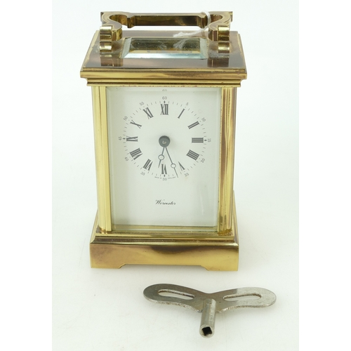 799 - 19th century brass Carriage clock, the dial marked Worcester Made in England, with key, height 15cm...