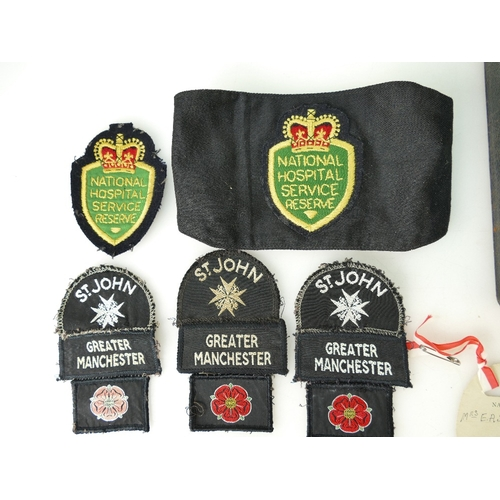 888 - Collection of St John Ambulance and National Hospital Service ephemera including enamel badges, clot...