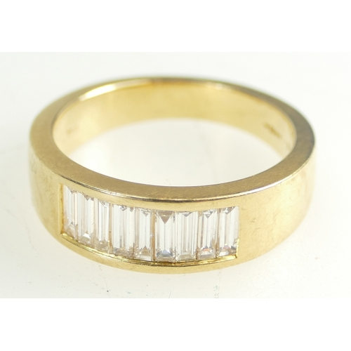 1398 - 18ct Gold Ladies Ring set with 9 Baguette diamonds, size R, 8.3 grams...