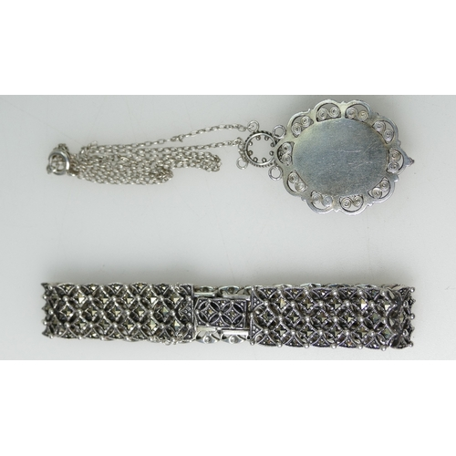 1411 - Silver Opal Pendant and chain and an ornate silver Bracelet, 38.8 grams...