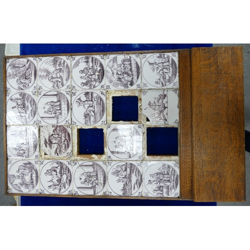 224 - 18th century Dutch Delft tile panel mounted in later oak frame, 19 tiles depicting various religious...