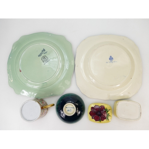 242 - A collection of pottery including a small Moorcroft orchid dish, Moorcroft Anemone box & cover, Clar...