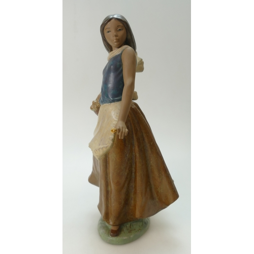 286 - Nina Flores Nao figurine of young girl holding a basket of flowers (Height 37cm) (Boxed)...