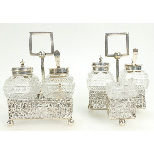 1122 - A pair of hallmarked silver cruet sets & condiments, Birmingham 1906 & Chester 1916. Weight of frame...