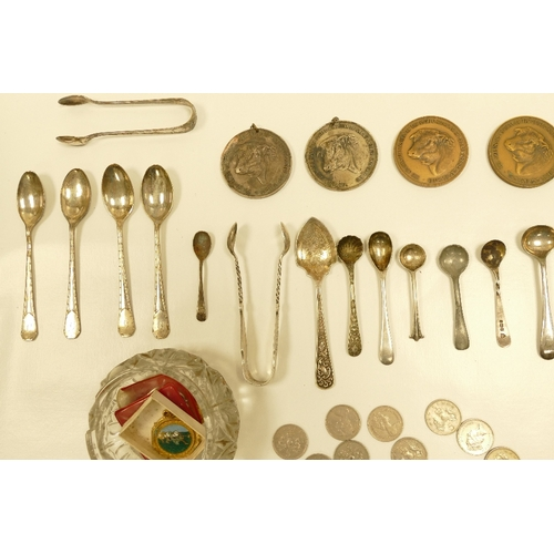 1127 - A mixed collection of items including Silver farming medals, Silver handled knife and spoons , coins...