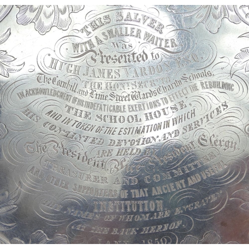 1151 - George III large silver salver, hallmarks for London 1831.  Measuring 44cm wide.  Weight 2039g.  Bea...