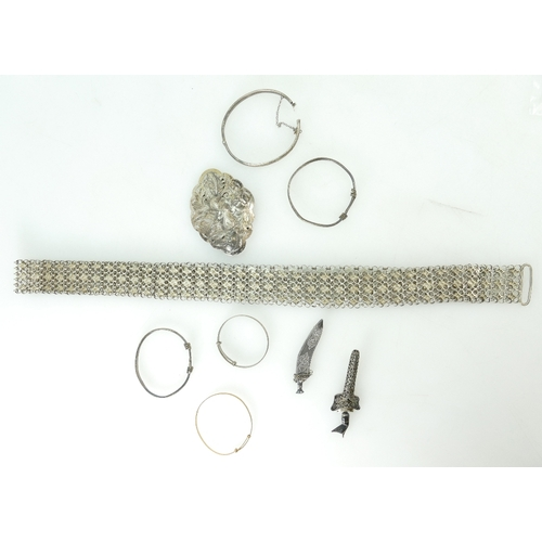 1172 - Malaysian Silver items including belt buckle, bangles Malaya Kriss etc, 194.4 grams, and 9ct gold ba...