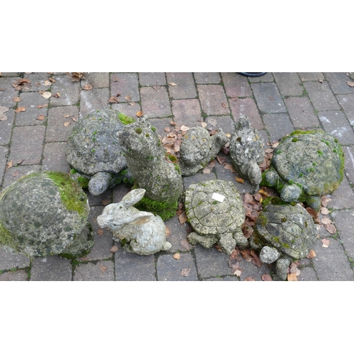17C - Collection of stone and resin garden animal ornaments (9)...