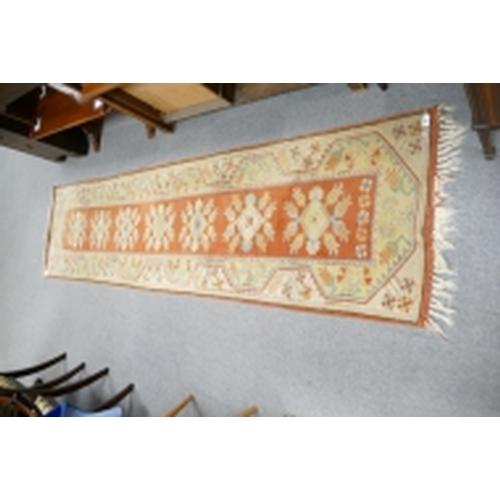 11 - Hand knotted hall rug...