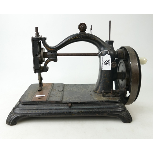 48 - Cast iron sewing machine with arch top, mid to later 19th century....