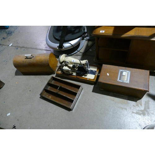 6 - Mid-century cased Sew-Tric sewing machine together with a paper till and a handled tray (3)...
