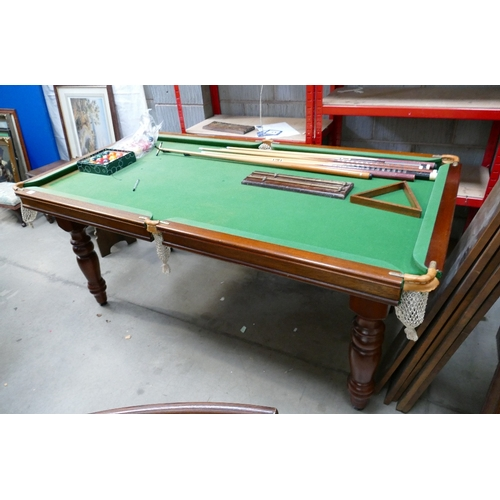 30 - Early 20th Century pool/ snooker table with 6 vintage cues, triangle and score counter, snooker & po...