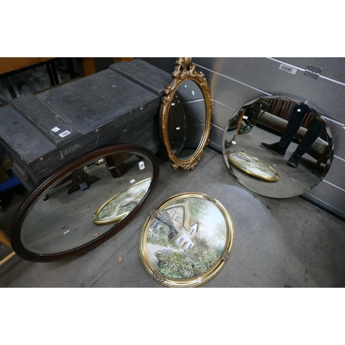 40 - A small selection of mirrors to include a Art Deco bevel edged circular mirror, mahogany framed oval...