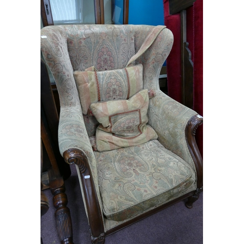 43 - Mahogony framed upholstered wing back arm chair...