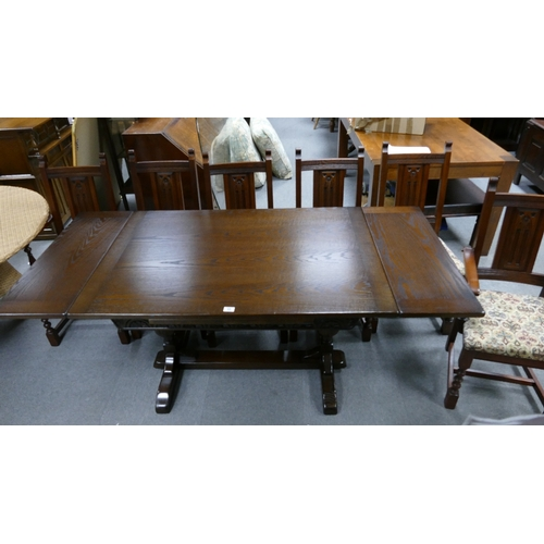 55 - 20th Century oak old charm extending pull out dining table and six matching chairs including two car...