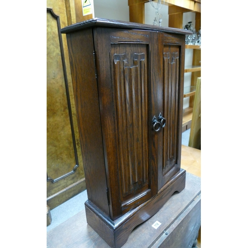 57 - 20th Century oak Jaycee small two door cabinet...