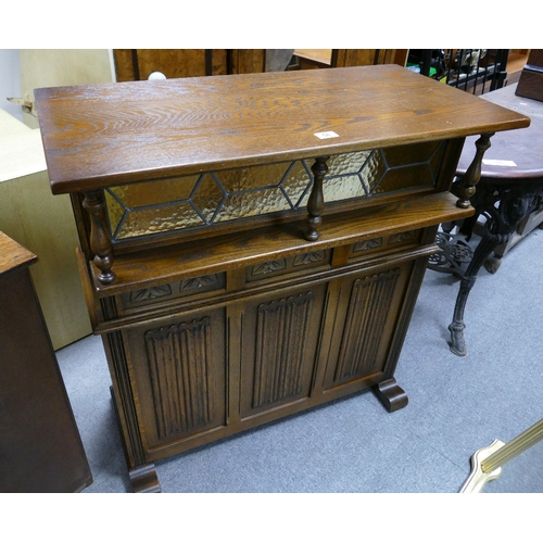 58 - 20th Century oak old charm bar / counter with leaded stained glaze and pillar overhang...
