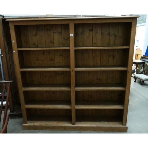 63 - Large five tier pine open bookcase...