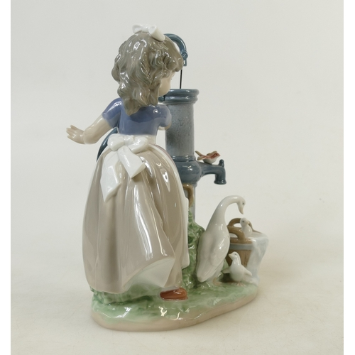 11 - Lladro figure titled 'Summer on the Farm': LLadro model 5285, height 24cm....