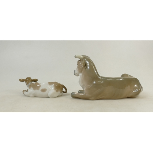 15 - Lladro Cattle Figures: Lladro figures of seated cow and calf. (2)...
